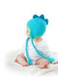 Bébé dans le chapeau de dinosaure Images stock