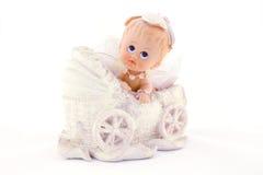 Bébé dans le chariot, d'isolement sur le blanc Image stock