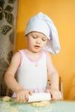Bébé dans le rôle de cuisinier Photographie stock libre de droits