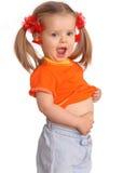 Bébé dans le T-shirt orange. photographie stock
