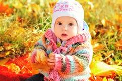 Bébé dans le temps de chute Photographie stock