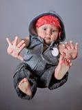 Bébé dans le type de coup sec et dur Photographie stock libre de droits