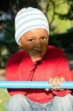 Bébé de couleur sur l'oscillation Image libre de droits