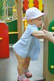 Bébé de fille sur le terrain de jeu Images stock