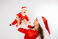 Bébé de Santa Claus et mère de Santa Claus Photos libres de droits