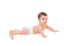 Bébé de six mois adorable dans la couche-culotte se trouvant sur le plancher Photo stock