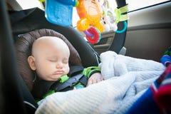 Bébé de sommeil dans Carseat photographie stock libre de droits