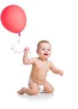 Bébé de sourire avec le ballon rouge Photo libre de droits