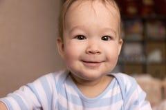 Bébé de sourire 7 mois Image stock
