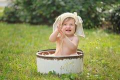 Bébé de sourire portant Bunny Bonnet Images stock