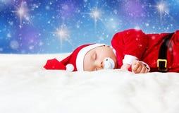 Bébé dormant dans le costume de Santa Photo stock