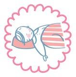 Bébé dormant sous un édredon Images stock