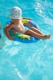 Bébé en boucle en caoutchouc Photographie stock libre de droits