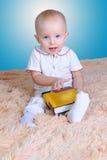Bébé et livre Images stock