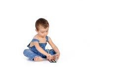 Bébé garçon avec une aquarelle Photo stock