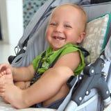 Bébé garçon dans une poussette Images libres de droits