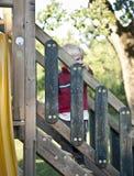 Bébé garçon sur le terrain de jeu Photographie stock libre de droits