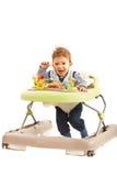 Bébé heureux dans le marcheur Photographie stock libre de droits