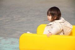 Bébé japonais sur la glissière Photographie stock libre de droits
