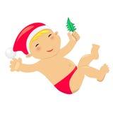 Bébé jouant avec le jouet d'arbre de Noël Photographie stock libre de droits