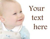 Bébé mignon et adorable avec des œil bleu image libre de droits