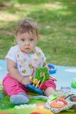 Bébé, moins que jouer an avec le jouet Images stock
