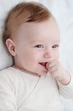 Bébé riant adorable photo stock