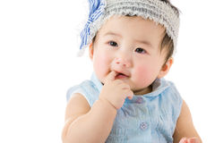 Bébé suçant le doigt image stock