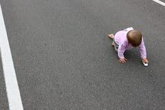 Bébé sur la route Photos libres de droits