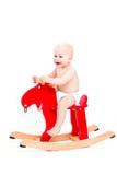 Bébé sur le cheval ou les élans de jouet Photos libres de droits