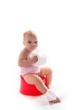 Bébé sur le pot, fond blanc Image stock