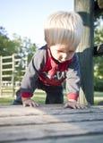 Bébé sur le terrain de jeu Photos libres de droits