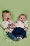 Bébés dans des vêtements de l'hiver Images libres de droits