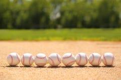 béisbol Bolas en campo fotos de archivo