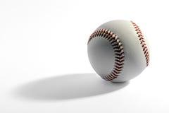 Béisbol con la sombra larga imagenes de archivo