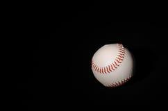 Béisbol en fondo negro Foto de archivo libre de regalías