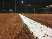 Béisbol en la noche Foto de archivo libre de regalías