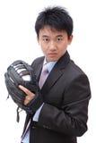 Béisbol joven del cabeceo del hombre de negocios Fotografía de archivo libre de regalías