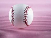 Béisbol sobre fondo rosado foto de archivo libre de regalías