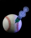 Béisbol y jeringuilla Fotos de archivo