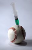 Béisbol y jeringuilla en un fondo ligero Fotografía de archivo