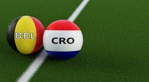Bélgica contra Fósforo de futebol da Croácia - bolas de futebol em cores nacionais de Bélgica e de Croácia em um campo de futebol Fotos de Stock Royalty Free