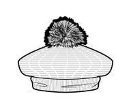 Béret tricoté par blanc avec le pom-pom Photo stock