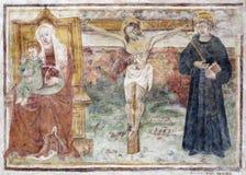 Bérgamo - fresco de la crucifixión del bianco del pozzo del al de Micaela de la iglesia. Fotografía de archivo libre de regalías