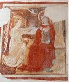 Bérgamo - fresco de la escena del anuncio del bianco del pozzo del al de Micaela de la iglesia. Fotos de archivo libres de regalías