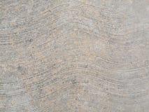 Béton rugueux avec les lignes onduleuses Image libre de droits