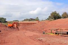 Bêcheur sur un chantier de construction Image stock