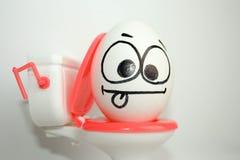 Ból w podbrzusza pojęciu komicznym Jajko z obraz stock