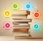Böcker överst med färgrika symboler på tappningbakgrund Royaltyfria Foton