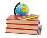 Böcker, blyertspennor och jordklot Fotografering för Bildbyråer